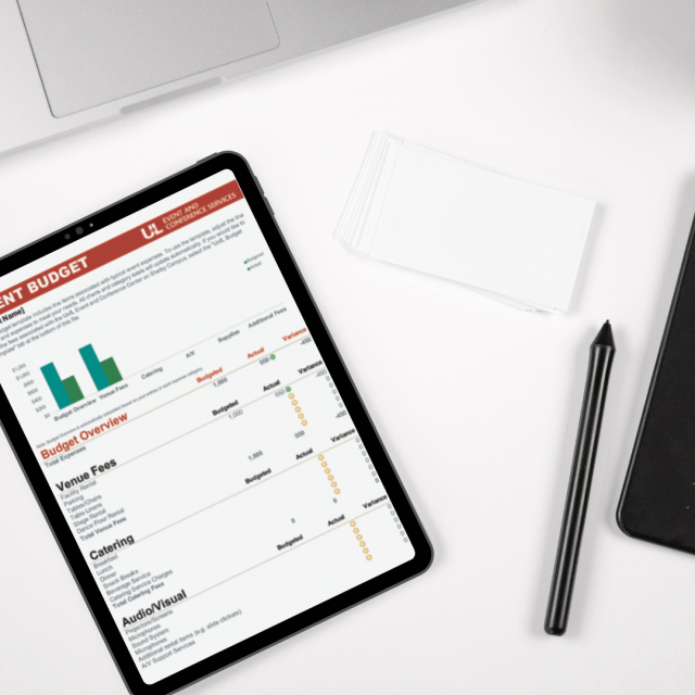 tablet on desk with budget template on screen
